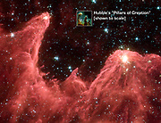 Spitzer Space Telescope false-colour image of 'mountains' where stars are born. Dubbed 'Mountains of Creation' the towering pillars of cool gas and dust are lit at the tips with light from embryo stars. Credit NASA. Science Astronomy