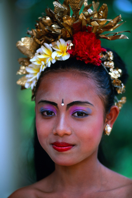 Young Balinese dancer at a school cultural performance, Peliatan, Bali, Indonesia
