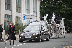 © Licensed to London News Pictures . 30/06/2017 . Stockport , UK . The funeral procession arrives . The funeral of Martyn Hett at Stockport Town Hall . Martyn Hett was 29 years old when he was one of 22 people killed on 22 May 2017 in a murderous terrorist bombing committed by Salman Abedi, after an Ariana Grande concert at the Manchester Arena . Photo credit : Joel Goodman/LNP