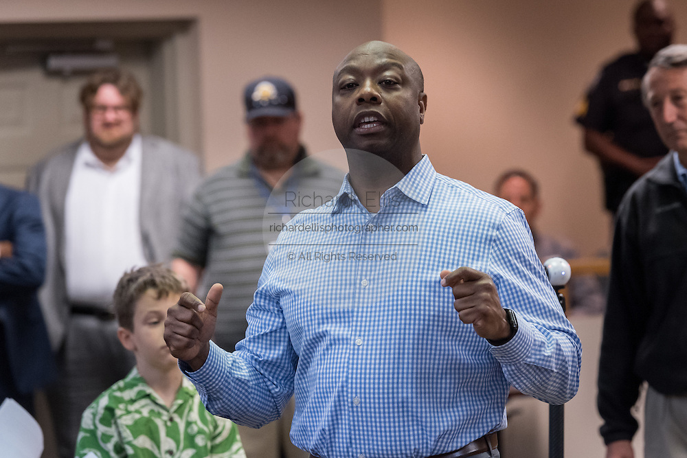 U.S. Sen. Tim Scott answers a question during a town hall meeting with constituents February 18, 2017 in Mount Pleasant, South Carolina. Hundreds of concerned residents turned up for the meeting to address their opposition to President Donald Trump during a vocal meeting held by U.S. Rep. Mark Sanford and Senator Tim Scott.