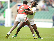 LONDON, ENGLAND - Sunday 11 May 2014, Seabelo Senatla of South Africa grabs Billy Odhiambo of Kenya during the Plate final match between South Africa and Kenya at the Marriott London Sevens rugby tournament being held at Twickenham Rugby Stadium in London as part of the HSBC Sevens World Series.<br /> Photo by Roger Sedres/ImageSA