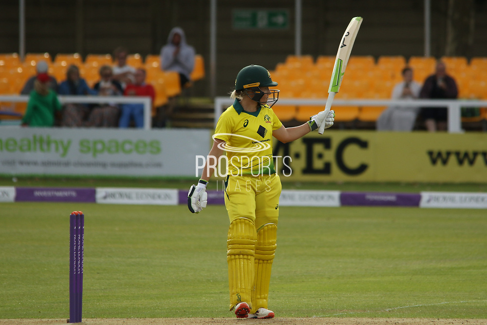 50 - Alyssa Healy acknowledges the crowd on reaching 50 watched in the background by Mitchell Starc (grey hoodie)during the Royal London Women's One Day International match between England Women Cricket and Australia at the Fischer County Ground, Grace Road, Leicester, United Kingdom on 2 July 2019.