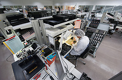 SOLMS, GERMANY - MAY-18-2009 - A technician assembles Leica M7 film cameras.  (Photo © Jock Fistick)