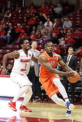 21 November 2015: Anthony Odunsi(2) passes the three point line guarded by Paris Lee(1). Illinois State Redbirds host the Houston Baptist Huskies at Redbird Arena in Normal Illinois (Photo by Alan Look)