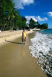 Barbados: Woman on beach, model released.   Photo barbad102.Photo copyright Lee Foster, 510/549-2202, lee@fostertravel.com, www.fostertravel.com