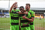 Forest Green Rovers Reece Brown(10) scores a goal 0-2 and celebrates with Forest Green Rovers Carl Winchester(7) and Forest Green Rovers Christian Doidge(9) during the EFL Sky Bet League 2 match between Port Vale and Forest Green Rovers at Vale Park, Burslem, England on 23 March 2019.
