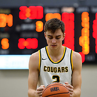 2nd year guard Samuel Hillis (2) of the Regina Cougars in action during the home game on December  2 at Centre for Kinesiology, Health and Sport. Credit: Arthur Ward/Arthur Images