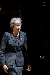 © Licensed to London News Pictures. 24/07/2018. London, UK. British Prime Minister Theresa May meets the Emir of Qatar Tamim bin Hamad Al Thani (not pictured) in Downing Street for talks and a working lunch. Controversy has arisen after a casting agency were found to be advertising for paid extras to demonstrate outside the meeting. The casting agency has since removed the advert. Photo credit : Tom Nicholson/LNP