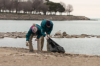 "The Jackson Park Advisory Council celebrated Earth Day Saturday afternoon, April 21st, 2018 with a clean up of 57th Street Beach. Volunteers from all over the city came to help.<br /> <br /> 7329, 7332 – Volunteers, Teresa Hager and Lee Milligan help pick up garbage off the beach.<br /> <br /> Please 'Like' ""Spencer Bibbs Photography"" on Facebook.<br /> <br /> Please leave a review for Spencer Bibbs Photography on Yelp.<br /> <br /> Please check me out on Twitter under Spencer Bibbs Photography.<br /> <br /> All rights to this photo are owned by Spencer Bibbs of Spencer Bibbs Photography and may only be used in any way shape or form, whole or in part with written permission by the owner of the photo, Spencer Bibbs.<br /> <br /> For all of your photography needs, please contact Spencer Bibbs at 773-895-4744. I can also be reached in the following ways:<br /> <br /> Website – www.spbdigitalconcepts.photoshelter.com<br /> <br /> Text - Text ""Spencer Bibbs"" to 72727<br /> <br /> Email – spencerbibbsphotography@yahoo.com"