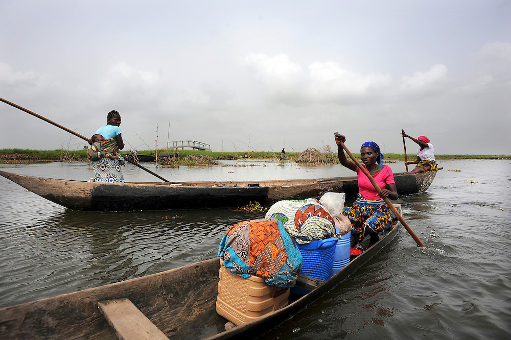 Beninese women work from their pirogues on the lagoon of Ganvie in Cotonou, Benin on March 1, 2008..