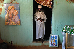 Priest Kewani stands inside St. Mary's church Coptic in Barentu, Eritrea August 27, 2006.  (Photo by Ami Vitale)