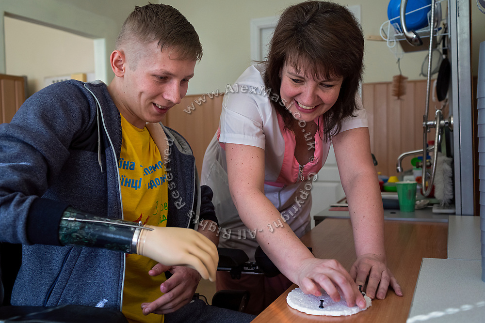 After loosing his right arm and leg to an artillery round that destroyed his shelter in July 2016, Serhiy Bilan, 23, is undergoing rehabilitation practises at the 'Ukrainian Scientific Experimental Institute for Prostheses and Rehabilitation' in Kharvik, the country's second-largest city, located in east. He was wounded after only two months of serving in the army and now wishes to learn coding, work in IT and in computer games.