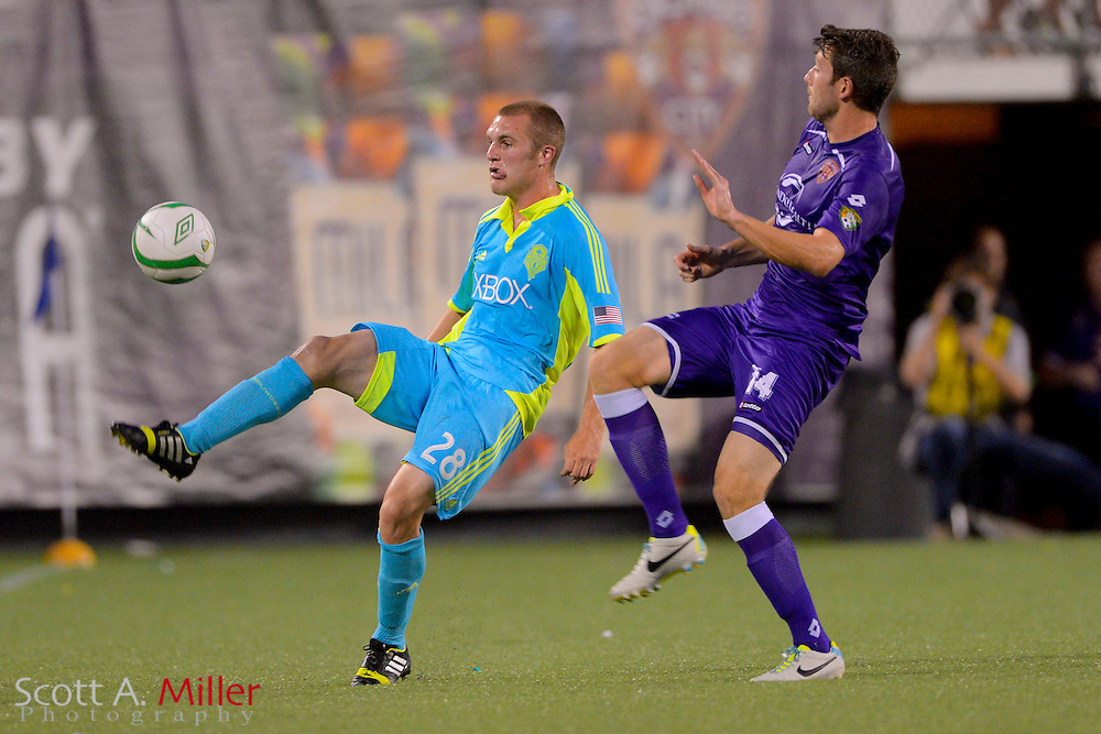 Seattle Sounders forward Will Bates (28) and Orlando City Lions midfielder Luke Boden (14)  go for  a ball during a USL Pro soccer game at the Citrus Bowl on Aug. 11, 2013 in Orlando, Florida. <br /> <br /> &copy;2013 Scott A. Miller