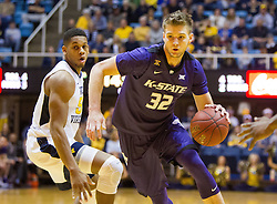 Feb 11, 2017; Morgantown, WV, USA; Kansas State Wildcats forward Dean Wade (32) drives down the lane during the first half against the West Virginia Mountaineers at WVU Coliseum. Mandatory Credit: Ben Queen-USA TODAY Sports
