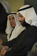 Former lawmaker Faisal Al-Mislem (F), in a pensive pose while Ahmad Al-Sadoun (B), veteran Kuwaiti politician and three-time former Speaker of Parliament, looks on during a rally to mark the inauguration of the elections HQ of Al-Sadoun in Kuwait City on Jan 18. Some 340 candidates, including both Al-Mislem and Al-Sadoun, are running in the Feb. 2, 2012 polls to elect a new 50-seat National Assembly (parliament).
