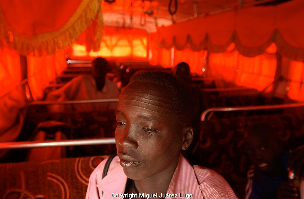 A young Nuer boy, waits inside a bus, on his way back to Bor from the town of Ayod, days after of the celebration of the referendum for independence in South Sudan.  (PHOTO: MIGUEL JUAREZ LUGO)