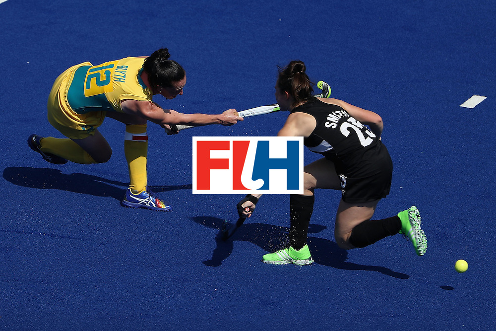 RIO DE JANEIRO, BRAZIL - AUGUST 15:  Madonna Blyth #12 of Australia shoots the ball past Kelsey Smith #25 of New Zealand during the second half of the quarter final hockey game on Day 10 of the Rio 2016 Olympic Games at the Olympic Hockey Centre on August 15, 2016 in Rio de Janeiro, Brazil.  (Photo by Christian Petersen/Getty Images)