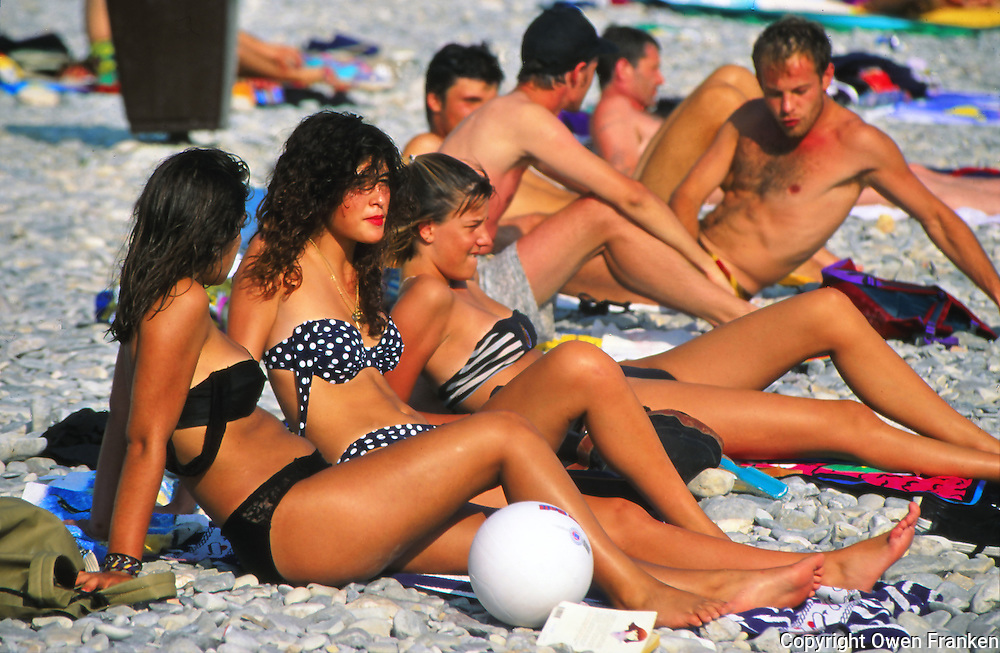 People sunbathing on the beach in Nice