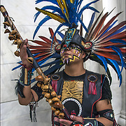 Portrait of Naz Cruz,praying in the four directions. He is a dancer in Danza Mexikah, the image  taken after ceremonial dance on the Day of the Dead on the rotunda in the National Museum of the American Indians.<br />