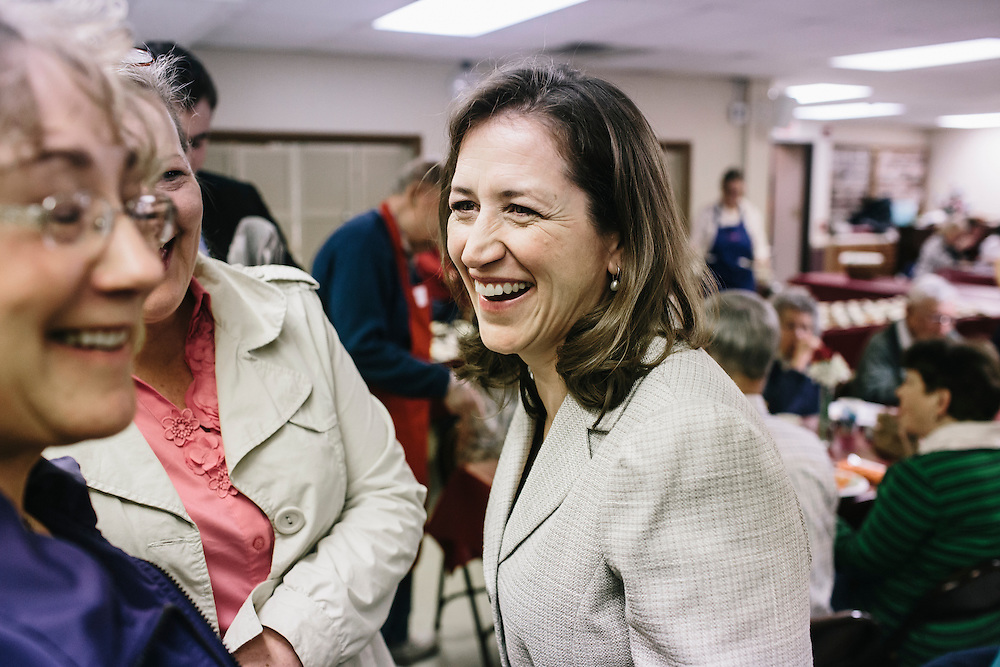 West Virginia Secretary of State Natalie Tennant, right, talks with guests Cathy Evans, left, and Cathy Simon, left, at the Romney First United Methodist Church in Romney, W.V. on Wednesday, April 16, 2014. Tennant is running for the US Senate seat in West Virginia against popular Republican Rep. Shelley Moore Capito.