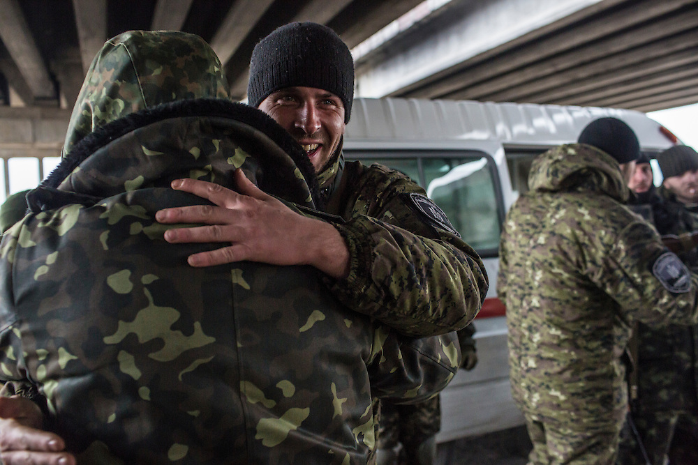 PERVOMAISKE, UKRAINE - NOVEMBER 18, 2014: Members of the 5th platoon of the Dnipro-1 brigade, a pro-Ukraine militia, greet the arrival of their colleagues at their post underneath a bridge in Pervomaiske, Ukraine. CREDIT: Brendan Hoffman for The New York Times