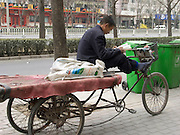 man reading a book while waiting for a job China Beijing
