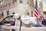 Volunteers loaded on pickups rush through downtown to assist police, fire fighters and other rescue workers in their search for possible survivors at the Ground Zero, World Trade Center site, in the days after the terrorist attacks.