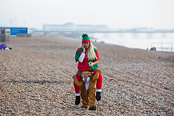 © Licensed to London News Pictures. 17/12/2016. Brighton, UK. Members of the Brighton Surf Life Saving Club take advantage of the dry and sunny weather to have a extra long training session in the sea. Photo credit: Hugo Michiels/LNP