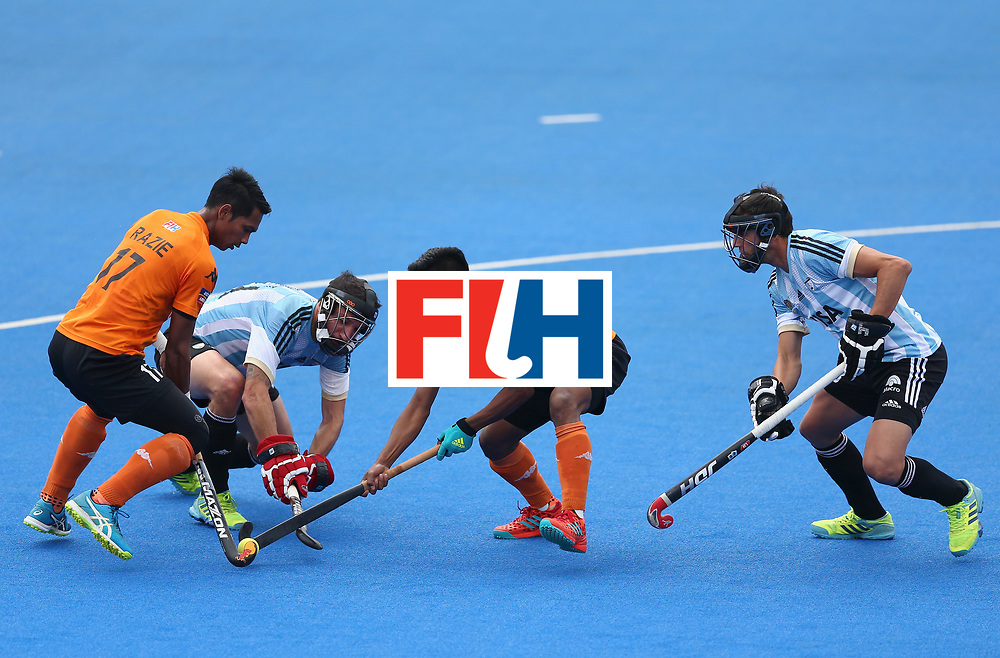 LONDON, ENGLAND - JUNE 24: Razie Rahim of Malaysia and Faizal Saari of Malaysia battle for possession with Manuel Brunet of Argentina and Lucas Rey of Argentina during the semi-final match between Argentina and Malaysia on day eight of the Hero Hockey World League Semi-Final at Lee Valley Hockey and Tennis Centre on June 24, 2017 in London, England. (Photo by Steve Bardens/Getty Images)