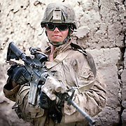 Location:<br /> Patrol Base Fires, Sangin District, Helmand Province, Afghanistan<br /> <br /> Unit: <br /> 3rd Squad, 1st Platoon, Bravo Company, 1st Battalion, 5th Marines<br /> <br /> Name and Rank:<br /> Hospitalman Matthew Thomas &quot;Doc&quot; Foreit<br /> <br /> Age: 25<br /> <br /> Hometown: Stone Park, Illinois<br /> <br /> Interview selections:<br /> <br /> Describe Sangin:<br /> <br /> &quot;It looks almost literally just like back home. Like, literally, there are times when I don&rsquo;t even realize I&rsquo;m in a different country. Especially if I&rsquo;m in the middle of a corn field or something I&rsquo;ll feel like I&rsquo;m just somewhere near Peoria or something.&quot;<br /> <br /> &quot;A lot of us out here call it 'Vietstan' as a kind of nickname. I would say I think it's my generation's Vietnam.&quot;<br /> <br /> What were your expectations before you came here?<br /> <br /> &quot;I had been told constantly about how graphic it was over here, about 3/5 [the previous unit] and how they'd been losing corpsmen, especially their corpsmen . . . left and right. That's all I heard about . . . so for the first week I was paranoid as hell. Pretty much for the first two months . . .&quot;<br /> <br /> What was your first casualty that you treated?<br /> <br /> &quot;My first casualty, when I got to him he had been pretty much . . . his legs were gone, at least the flesh around his legs was pretty much gone all the way up to his waist. <br /> <br /> Pretty much like six inches below his hip was like where it had stopped, and everything else below that was just bone. His perineum . . . the blast had shot straight up in to him, and his genitals, while they were intact, had been pushed up into his abdomen, and everything else around his perineum and the underside of his thighs were just torn up.<br /> <br /> It was pretty much just seared raw flesh&quot;<br /> <br /> What did you try to do to save him?<br /> <br /> &quot;The first thing I did is first off I tried getting the tourniquets on him. Like I said, the flesh around his leg was gone almost to the point where it was hard to get a tourniquet on him. I&rsquo;m not gonna lie, even the metal one, I had a lot of difficulty trying to get it on his leg because it was slipping off his leg a