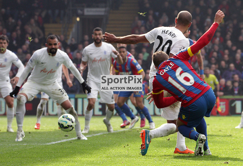 Dwight Gayle wraps his foot around a shot during the game between Crystal Palace and Queens Park Rangers on Saturday 14th March 2015