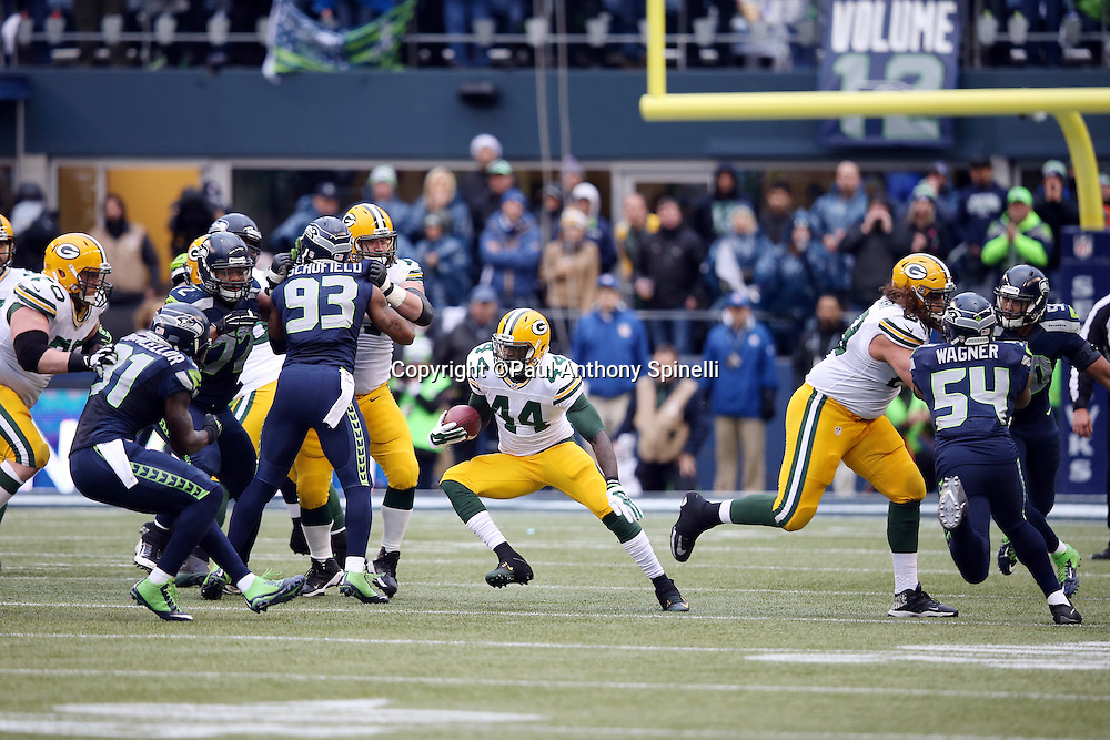 Green Bay Packers running back James Starks (44) makes a cut as he runs for a fourth quarter gain of 32 yards to the Seattle Seahawks 43 yard line during the NFL week 20 NFC Championship football game against the Seattle Seahawks on Sunday, Jan. 18, 2015 in Seattle. The Seahawks won the game 28-22 in overtime. ©Paul Anthony Spinelli