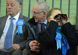 © Licensed to London News Pictures. 01/03/2013. Eastleigh, UK A woman uses binoculars to watch the count. Ballot boxes begin to arrive at the count centre at  Fleming Park Leisure Centre in Eastleigh this evening. The voters of Eastleigh vote to choose a new MP in a by-election prompted by the resignation of former Lib Dem cabinet minister Chris Huhne. Polling will continued 22:00 GMT 28/02/13, with votes counted overnight on Thursday. There are 14 candidates in total on the ballot papers.. Photo credit : Stephen Simpson/LNP