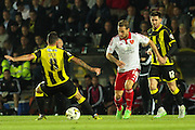 Sheffield United forward Billy Sharp slips the ball past Burton Albion midfielder Robbie Weir during the Sky Bet League 1 match between Burton Albion and Sheffield Utd at the Pirelli Stadium, Burton upon Trent, England on 29 September 2015. Photo by Aaron Lupton.