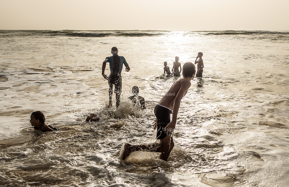Cabo Verde, Boa Vista, young surfers along the beach