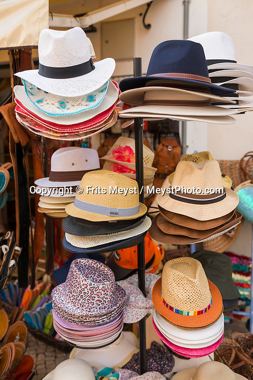 Lagos, Algarve, Portugal, October 2014. Shopping for souverneers and goodies in Lagos. A spectacular coastline of steep sandstone cliffs borders hidden sandy beaches on the south western tip of Europe, where the Mediterranean becomes the Atlantic Ocean.  Photo by Frits Meyst / MeystPhoto.com