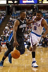 March 9, 2011; Sacramento, CA, USA;  Orlando Magic point guard Gilbert Arenas (1) dribbles past Sacramento Kings shooting guard Luther Head (9) during the first quarter at the Power Balance Pavilion.