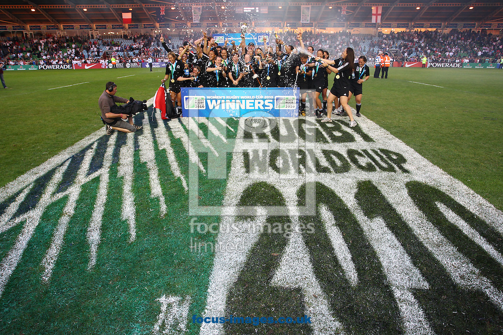 Twickenham Stoop, London, England - Sunday 9th September 2010: The New Zealand team splash the champagne after winning the IRB Womens Rugby World Cup Final between England and New Zealand 13-10 at The Stoop on September 9th 2010 (Photo by Andrew Tobin/Focus Images)