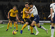 Son Heung-Min forward of Tottenham Hotspur (7) takes on Wolverhampton Wanderers defender Matt Doherty (2) during the Premier League match between Wolverhampton Wanderers and Tottenham Hotspur at Molineux, Wolverhampton, England on 3 November 2018.