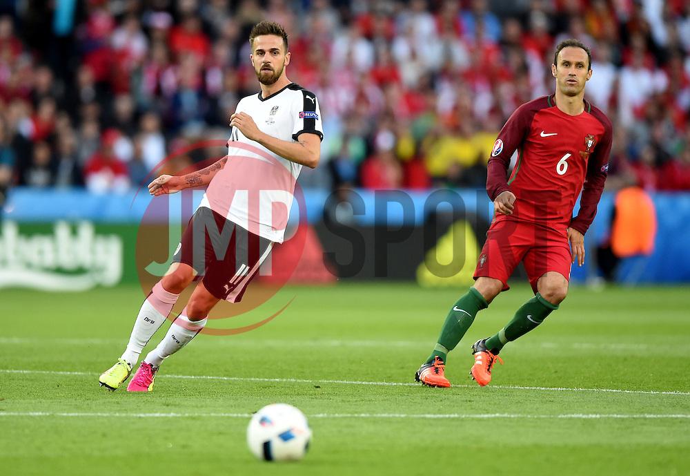 Martin Harnik of Austria in watched closely by Ricardo Carvalho of Portugal  - Mandatory by-line: Joe Meredith/JMP - 18/06/2016 - FOOTBALL - Parc des Princes - Paris, France - Portugal v Austria - UEFA European Championship Group F