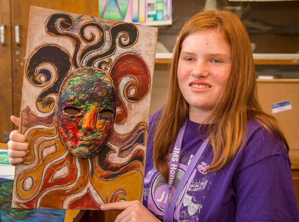 Johnston Middle School 7th grader Makaila Maniscalco with her art work, April 22, 2015.