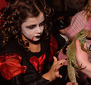 Tierney Smith of Fairborn gets up close and personal with Jade during Howl-O-Ween 2010 at the Boonshoft Museum of Discovery in Dayton, Saturday, October 23, 2010..