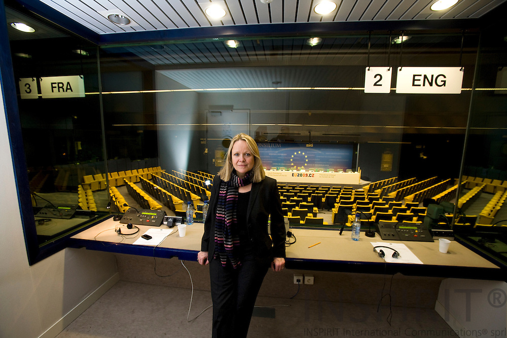 BRUSSELS - BELGIUM - 15 JANUARY 2009 -- Lisbet KROGAGER, Danish interpreter at EU-institutions here in the English interpreter box at the EU-Council pressroom.  Photo: Erik Luntang