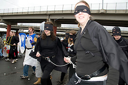"Participants waiting for the start of the 7th Annual Portland Urban Iditarod on Saturday, March 1st, 2008 in Portland, Oregon.  Organizers describe the event as  ""teams of ?dogs? lead by a musher will pull their sleds (shopping carts) through some of Portland?s most scenic areas. These teams of barking humans must negotiate through the unrelenting and unforgiving dangers of Portland?s urban frontier."".http://www.keepportlandweird.org/urbaniditarod/"