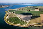 Nederland, Zeeland, St. Philipsland, 12-06-2009; St. Philipsland met de haven bij Sluis, gezien naar Schouwen-Duiveland. De haven, links van het midden, was in gebruik bij de veerdienst Anna Jacobapolder - Zijpe (op Schouwen-Duiveland) en wordt nu gebruikt voor het kweken van mosselen in hangcultuur..Swart collectie, luchtfoto (toeslag); Swart Collection, aerial photo (additional fee required).foto Siebe Swart / photo Siebe Swart