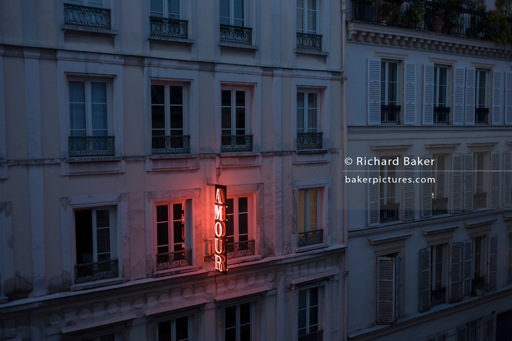 Neon sign outside the Amour Hotel at 8 rue Navarin, 9th Arrondissement, Paris, France.