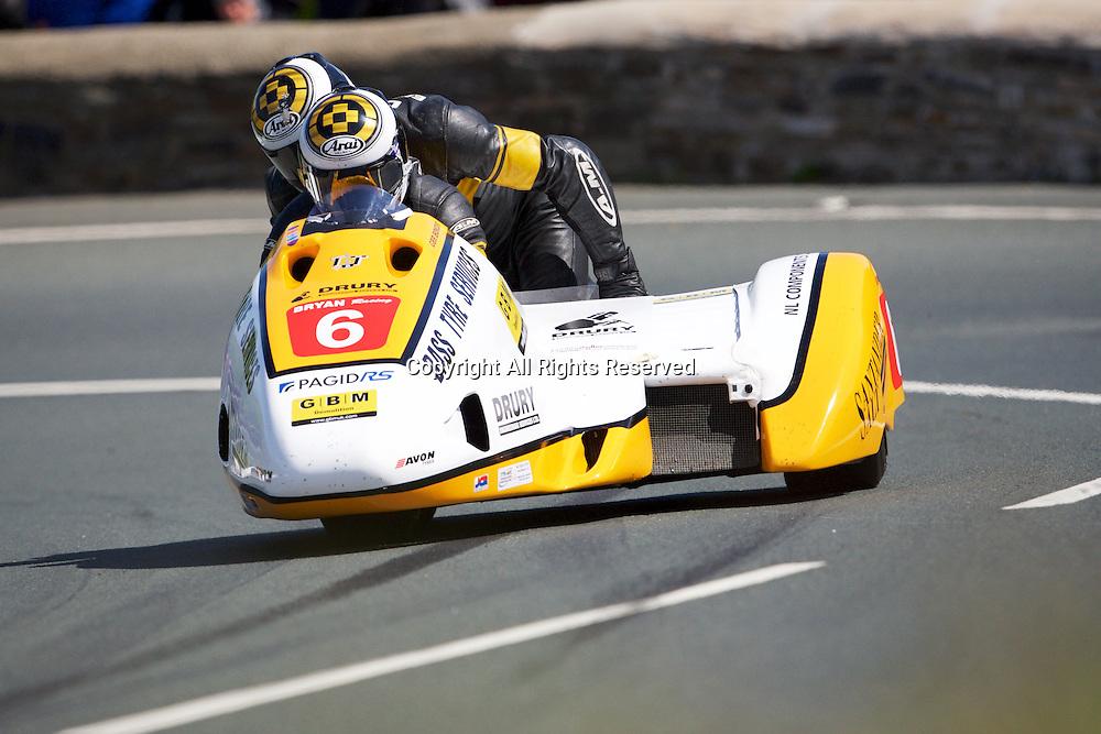 08.06.2015. Douglas, Isle of Man. 2015 Isle of Man TT Races. Gary Bryan and Jamie Winn in action during the TT Sidecar race.