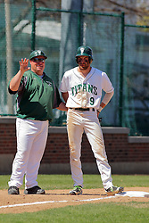 17 April 2016:  Dennis Martel and Adam Glogovsky have a chat as Adam Glogovsky reaches 3rd base during an NCAA division 3 College Conference of Illinois and Wisconsin (CCIW) Pay in Baseball game during the Conference Championship series between the North Central Cardinals and the Illinois Wesleyan Titans at Jack Horenberger Stadium, Bloomington IL