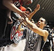 "Mississippi's Marshall Henderson (22) celebrates following a win over LSU at the C.M. ""Tad"" Smith Coliseum in Oxford, Miss. on Wednesday, January 15, 2013. Mississippi won 88-74 in overtime. (AP Photo/Oxford Eagle, Bruce Newman)"