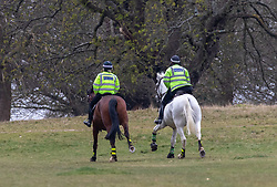 © Licensed to London News Pictures. 01/04/2020. London, UK. Mounted police officers patrol Richmond Park in South West London to keep a firm check on social distancing rules as the Coronavirus crisis continues. Photo credit: Alex Lentati/LNP
